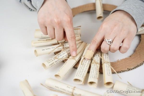 Gluing paper scrolls around cardboard