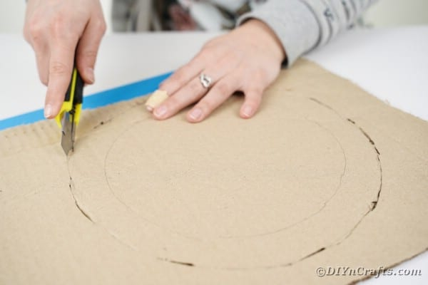 Cutting circle out of cardboard
