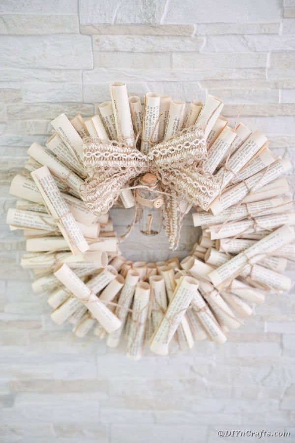 Scroll wreath on brick wall