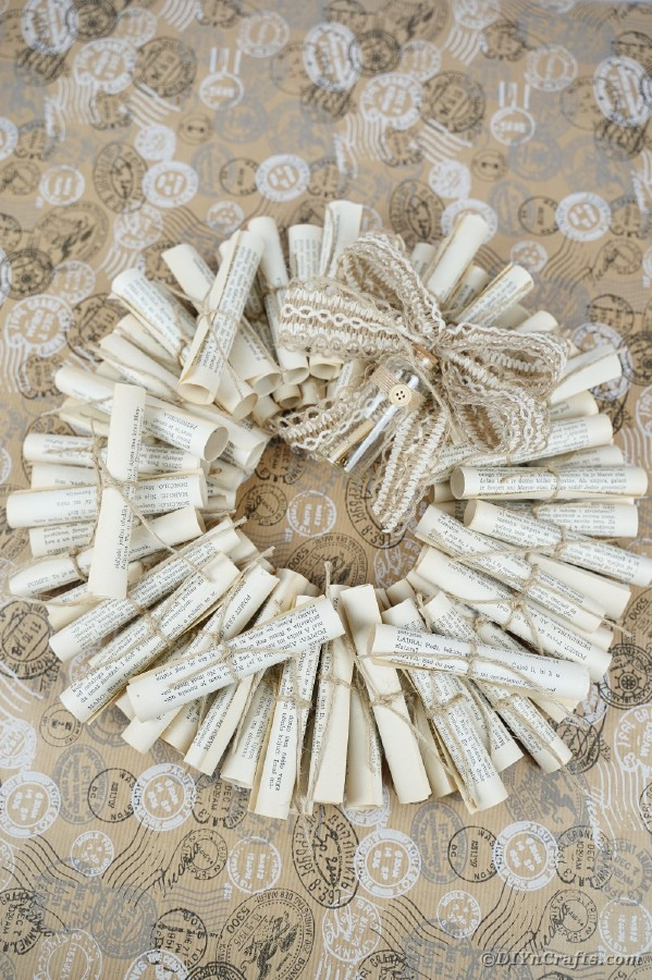 Scroll wreath on beige background