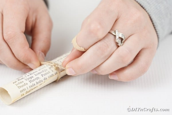 Tying twine on paper scroll