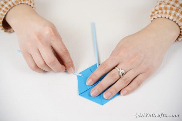 Gluing paper straw to base