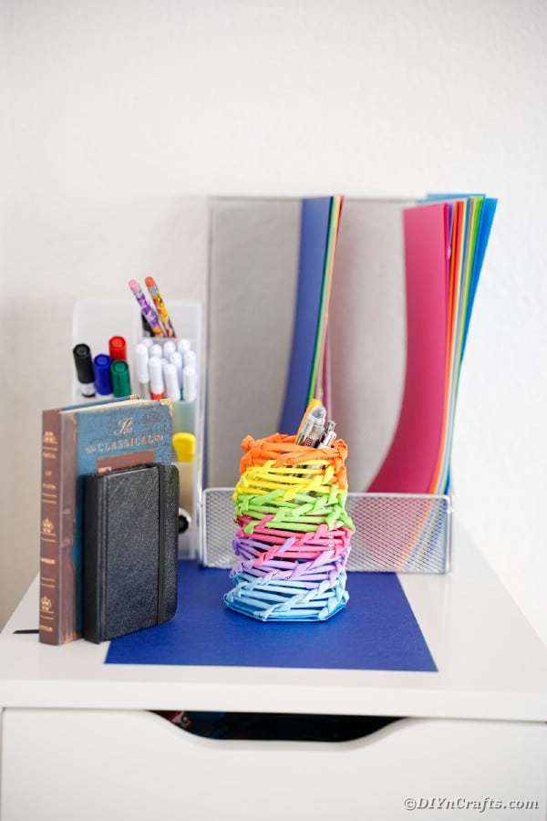 Rainbow organizer can on desk by papers