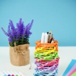 Rainbow desk organizer on table by markers