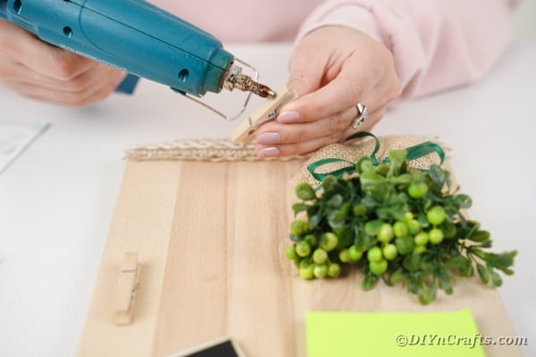Gluing clothespins to cutting board