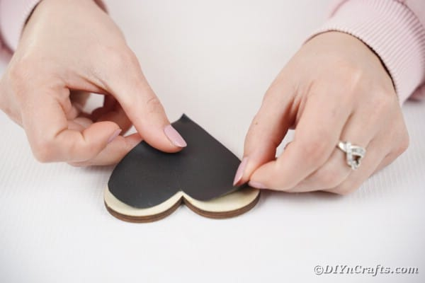 Attach chalkboard paper to wooden heart
