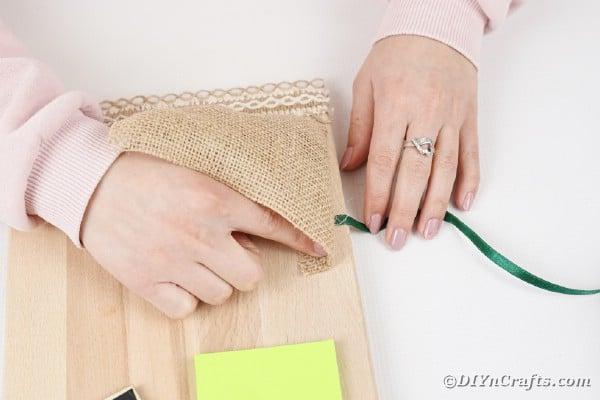 Adding burlap to cutting board