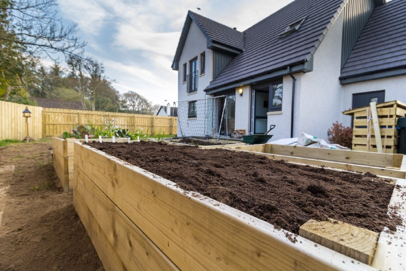Empty raised garden bed with perfect soil.