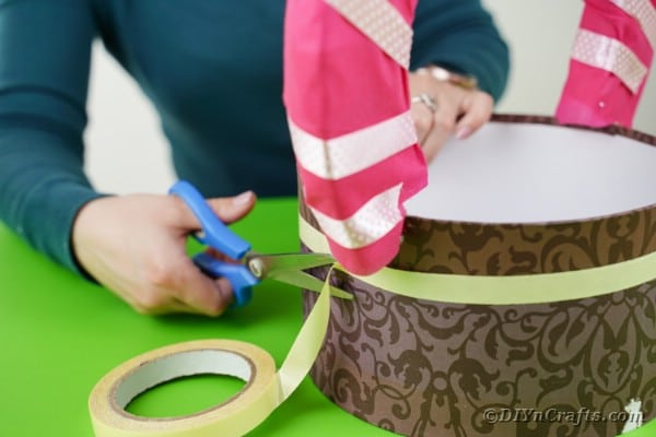 Adding double sided tape to hat box