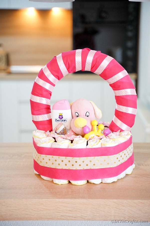 Pink diaper basket on kitchen table