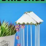 Birdcage by flower pot