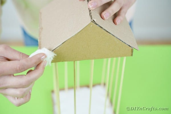 Adding petroleum jelly to edges of cardboard roof