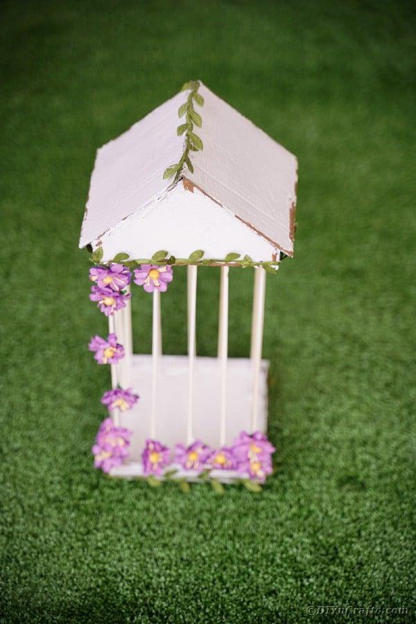 Homemade bird cage on grass