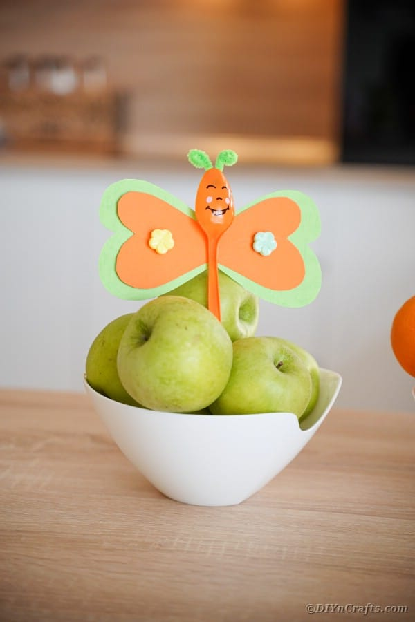 Orange butterfly spoon with apples