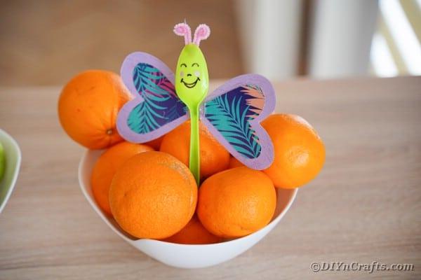 Purple butterfly spoon in oranges