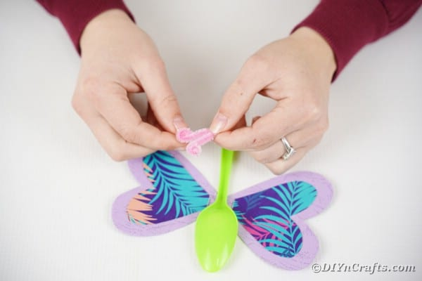 Adding pipe cleaner to top of butterfly