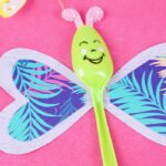 Green spoon on pink paper