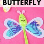 Butterfly spoon on pink surface