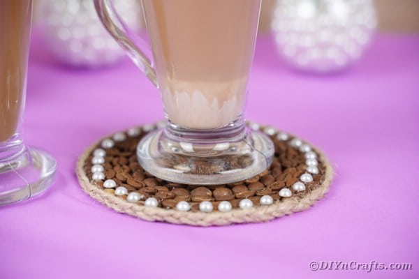 Coffee coaster on purple table