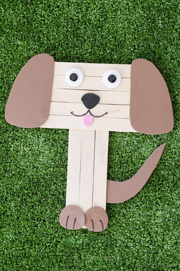 Craft stick puppy on grass