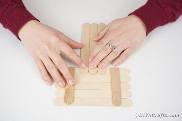 Gluing craft sticks together