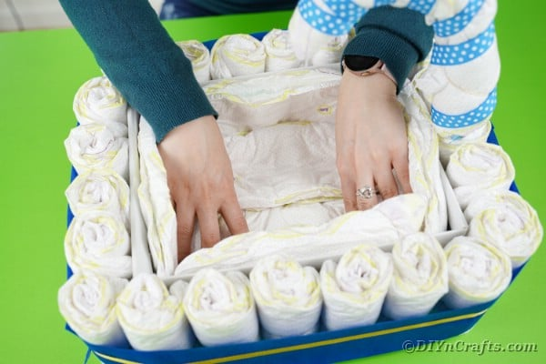 Lining the inside of the box with diapers