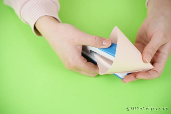 Stapling paper into a cone