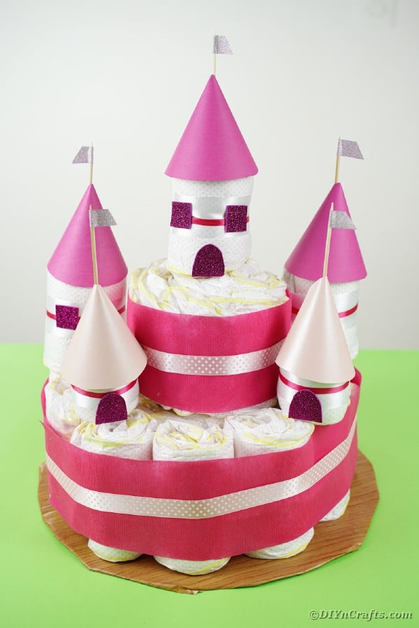 Castle diaper cake on green table