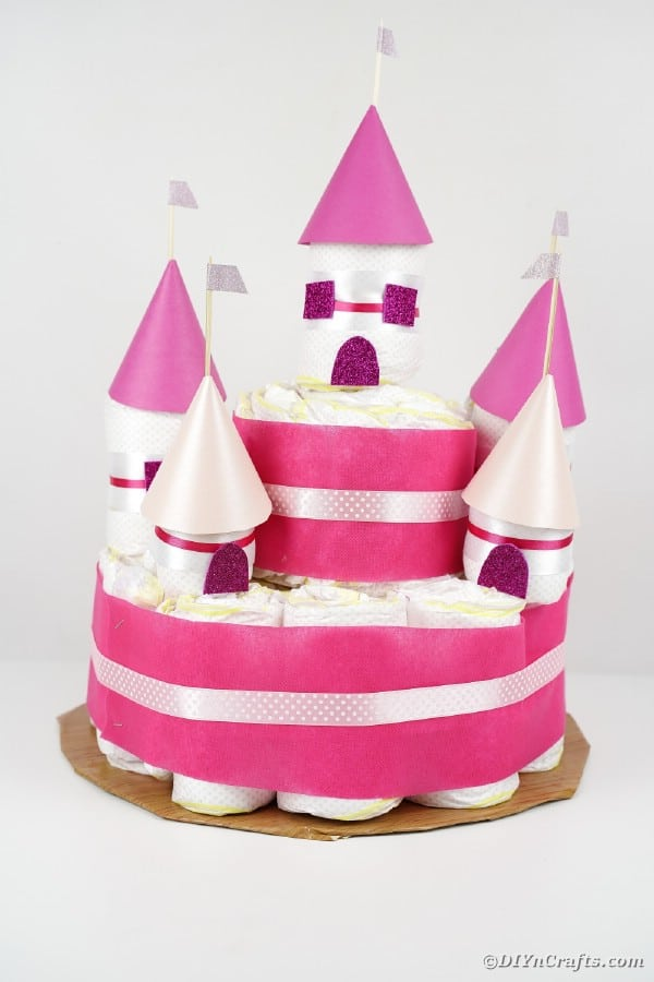 Pink diaper castle on white table