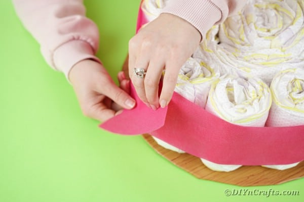 Stapling paper on diaper cake