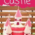 Diaper castle cake in front of wooden