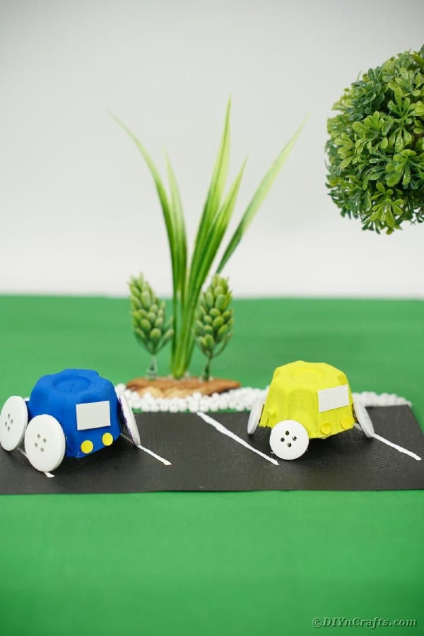 Blue egg carton car on green surface