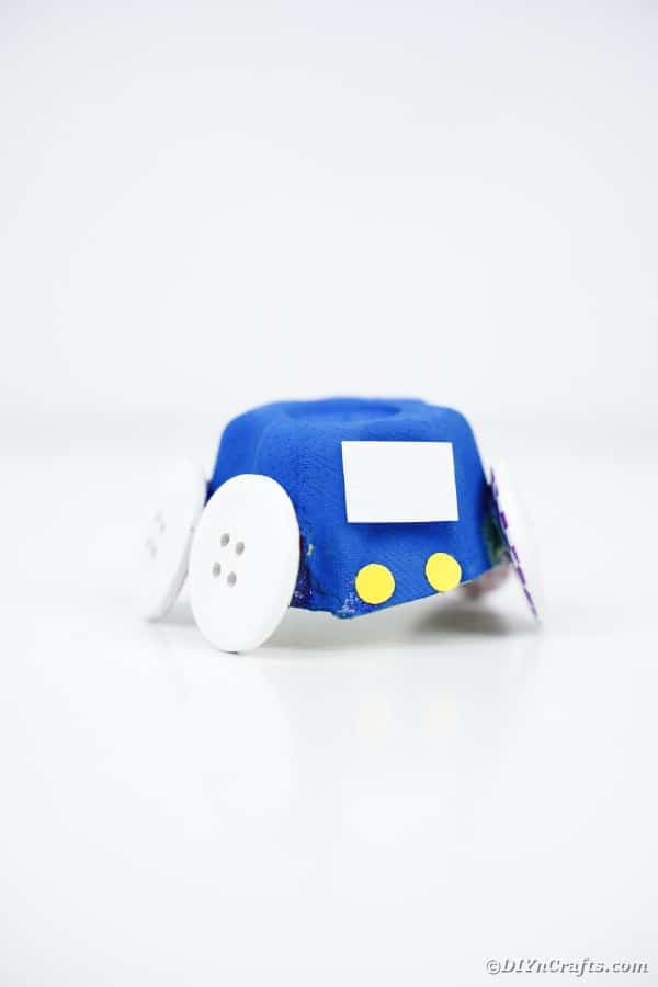 Blue egg carton car on white table