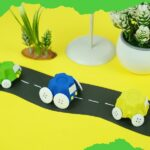 Toy egg carton cars on fake road