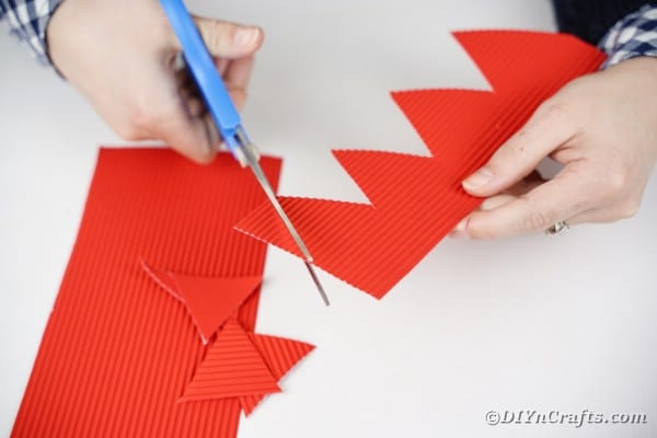Cutting spikes out of red cardboard