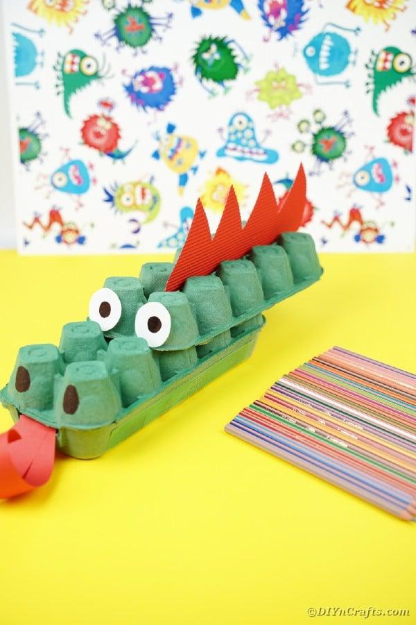 Egg carton dragon on yellow table