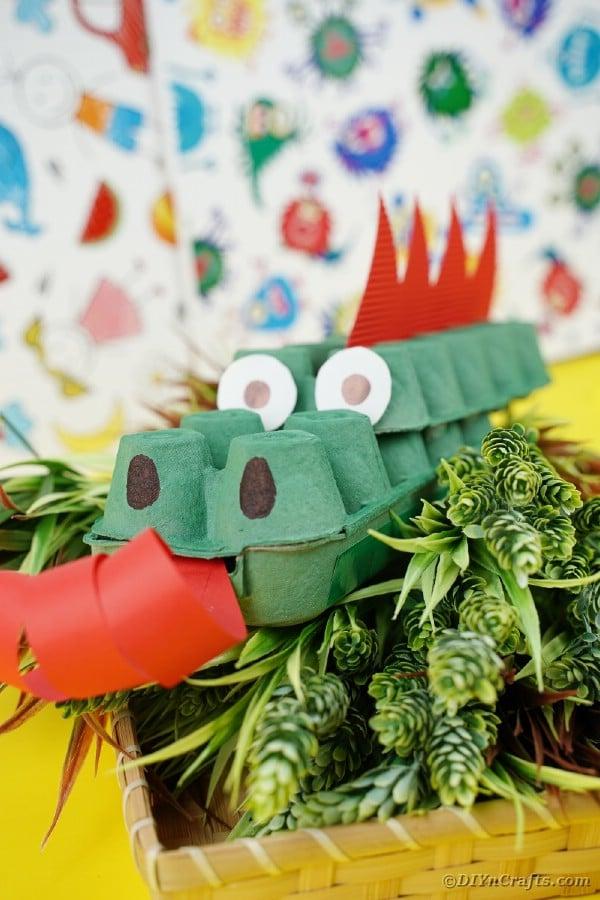 Dragon on greenery