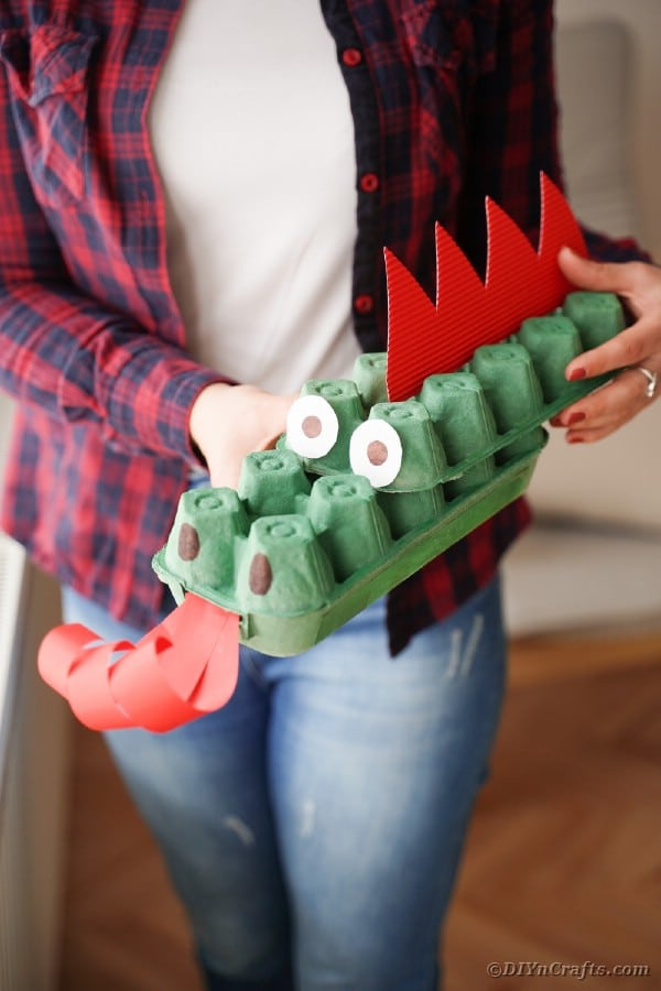 Woman holding egg carton dragon