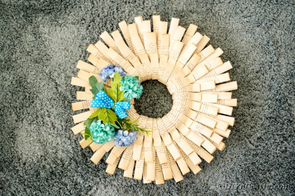 Folded book page paper wreath on carpet