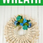 Folded paper wreath on shiplap white wall