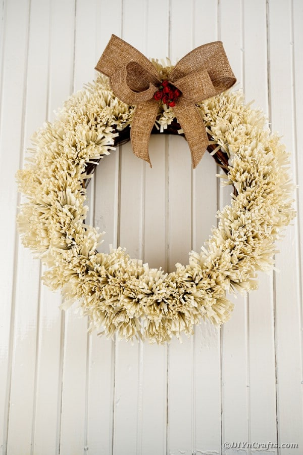 Paper wreath against white wooden boards