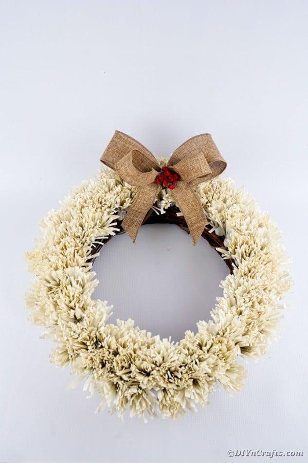 Fringed wreath against white background