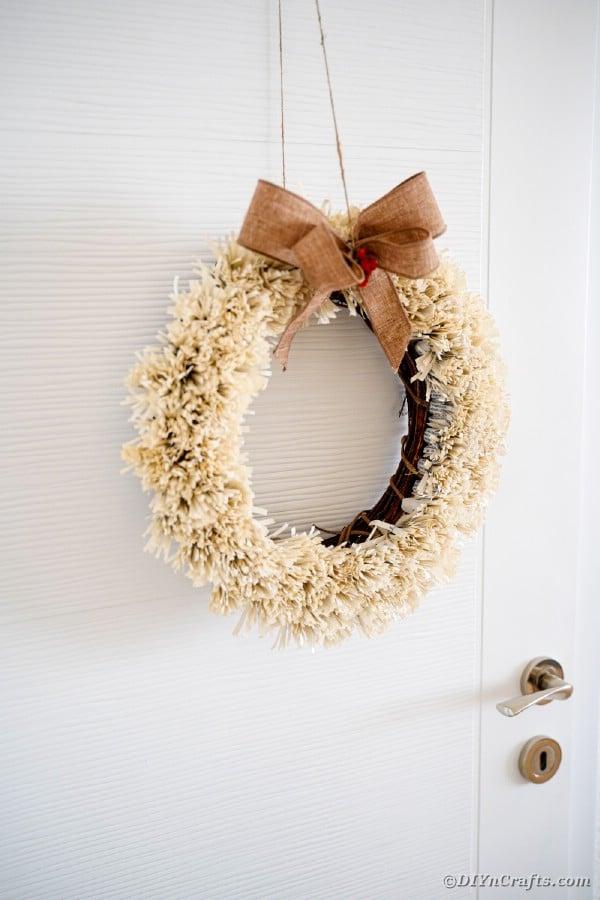 Fringed wreath against white door