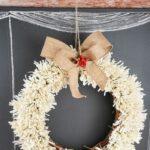 Fringed wreath hanging on chalkboard