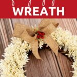 Paper fringed wreath on wooden surface