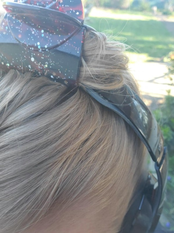 Hair clip holding headphones on head