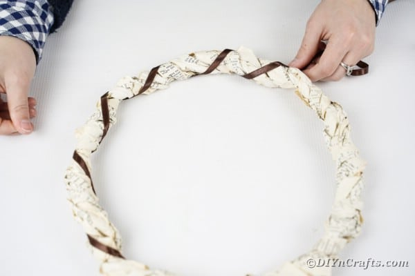 Gluing ribbon to book page wreath