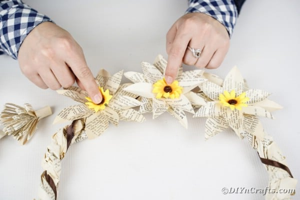 Attaching sunflowers to wreath