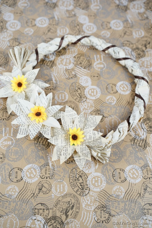 Old Book Page Wrapped Wreath on floral background