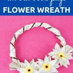 Grapevine wreath from book pages on pink surface